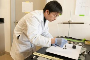 Bing Hui, a Stanford post-doctoral fellow, demonstrates Dr. Cui's nanotube coating technique.