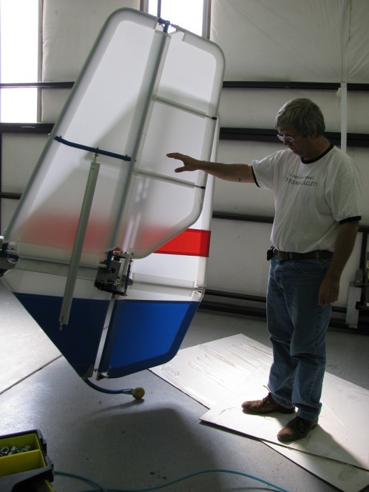 Brian demonstrates horizontal tail folding, which requires the removal of only one bolt on each side