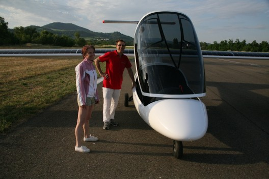 Irena and Eric Raymond with their two-seat, solar-powered Duo