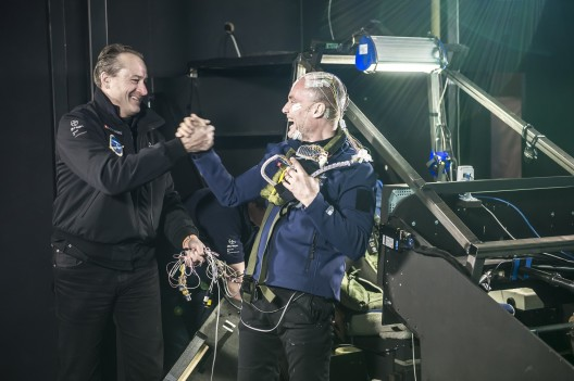 Andre' Borschberg greets Bertrand Piccard following successful 72-hour simulated crossing of Atlantic