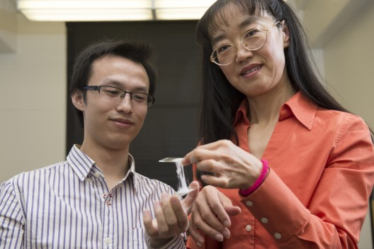Dr. Zhong and graduate student xxx hold example of sticky electrolyte