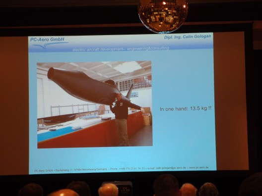 Calin Gologan demonstrated strength in lifting 13.5 kilogram (29.7 pound) Elektra One fuselage