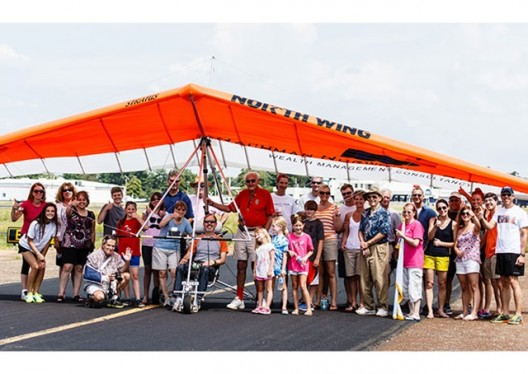 Gary Davis and ElectraFlyer trike surrounded by admirers following record flight