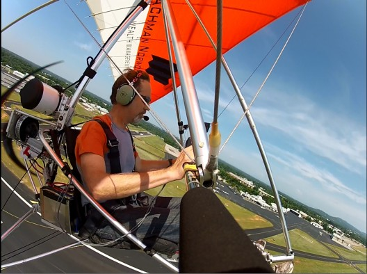 Gary Davis under Northwing Stratus wing showing steep climb angle with ElectraFlyer motor