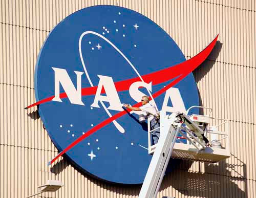 "Worker touches up the first ""A"" in NASA - for Aeronautics"