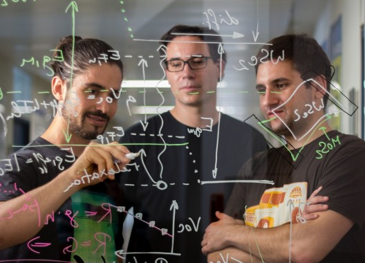 (Left to right) Marco Furchi, Thomas Mueller, and Andreas Pospichil sort out how to combine multiple layer semiconductors