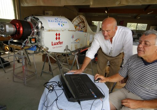 "Roman Marcinowski (standing) and Jean-Luc Soullier analyze data from their proprietary ""Aeroskysoft"" software"