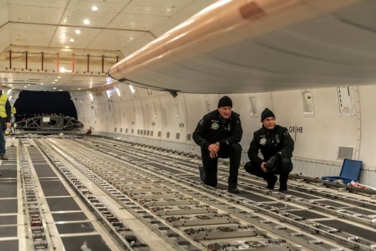 André Borschberg and Bertrand Piccard inspect the cargo hold that will contain their amazing aircraft