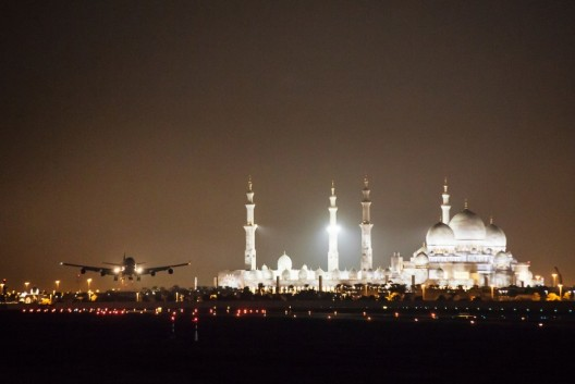 Modern technology meets middle-ages splendor.   747 lands at Abu Dhabi with solar-powered airplane aboard