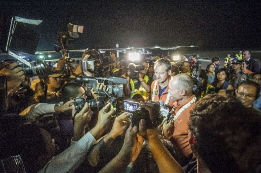 Andre' Borschber gnad Bertrand Piccard are surrounded by reporters and photographers after Piccard landed HB-SIB in Mandalay, Myanmar.  Photo Solar Impulse | Revillard