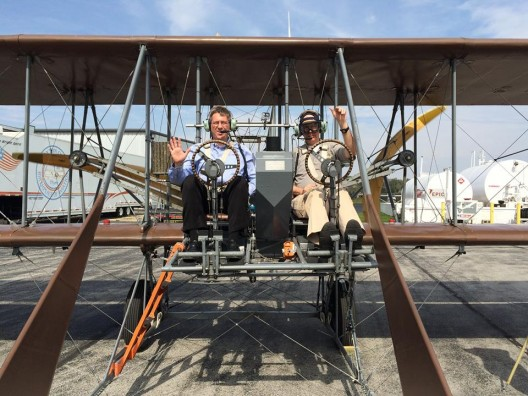 Eric Bartsch celebrating the 111th anniversary of powered, controlled flight in a Wright Flyer replica