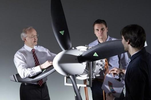 Dr. Frank Anton and associates examine 50 kilogram, 260 kilowatt motor