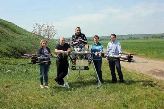 Flike's developers and pilot celebrate a first few successful flights