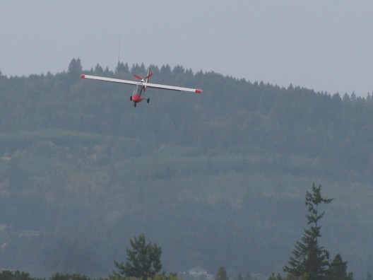 Mark Beierle on final into Twin Oaks Airpark.  Note large flaps for steep approaches, short landings