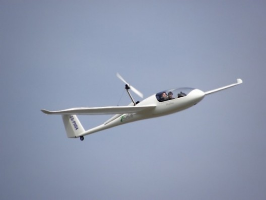 Pipistrel Taurus Electro in flight.  Now just imagine using two of these with a large center section holding two fuselages together and you have a G4, or a HY4