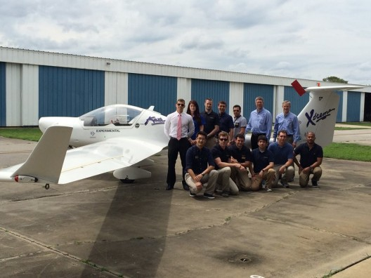 Eric Lindbergh, near tail, with Embry Riddle students working to electrify Diamond