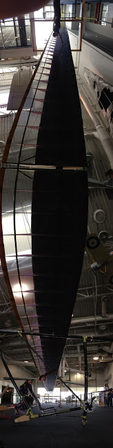 A panorama taken from under the wing of DaSH as it was assembled in the Hiller Aviation Museum's atrium