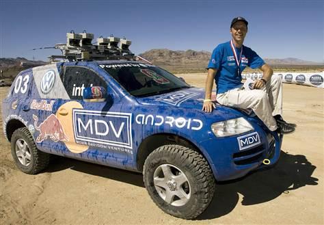 Sebastian Thrun sitting on 2005 DARPA Challenge winner. Sebastian heads up several Google developments, including Google Cars
