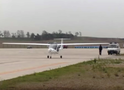 An early test flight of the RX1E. Note sailplane-like wings