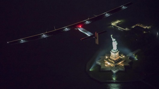 Two symbols of forward thinking: SI2 floats above Statue of Liberty