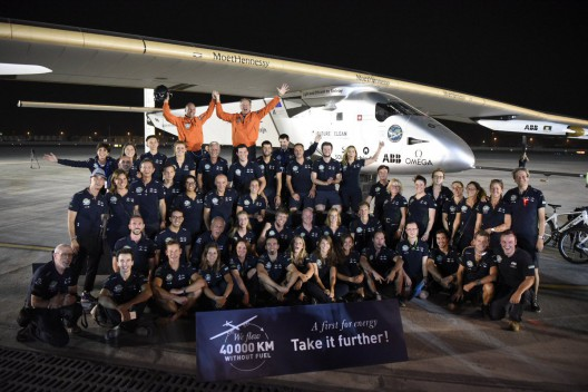 Only a small part of the people who showed up to greet Bertrand Piccard, Solar Impulse 2's ground crew helps document historic flight