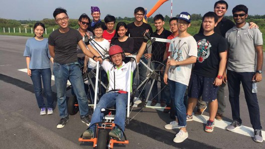 Pilot surrounded by NUS Delta team following successful test flight