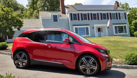 Tom Moloughney's 1,000 mpg BMW i3. It used less gas than he drinks in coffee per month, and less than his gardner's tractor burns mowing his two-acre lawn each year