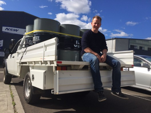 Jeremy with fuel drums. 10-percent plastic fuel could be supported by existing infrastructure